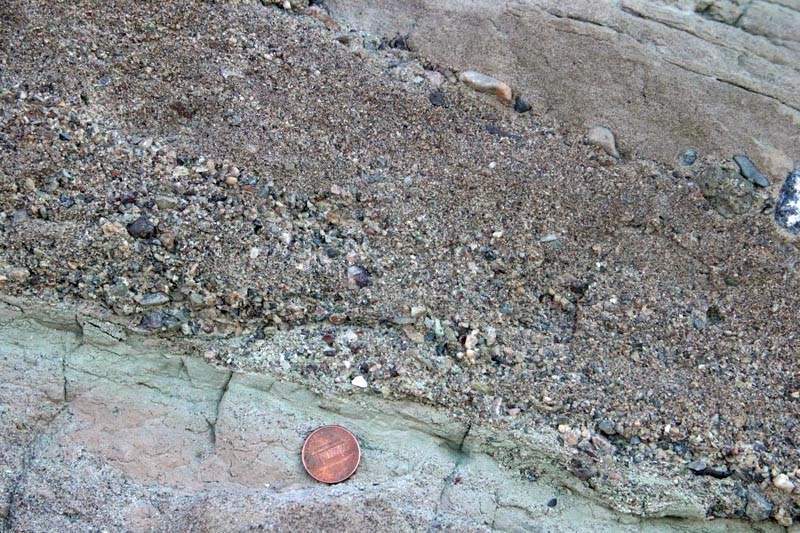 Graded bedding: pebble conglomerate up into sandstone.