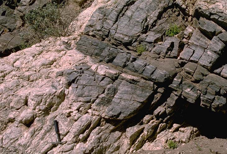 intrusive rocks Intrusive rocks crystallize and harden beneath the earth's surface in rock formations include plutons, batholiths, dikes, sills, laccoliths, and volcanic necks.